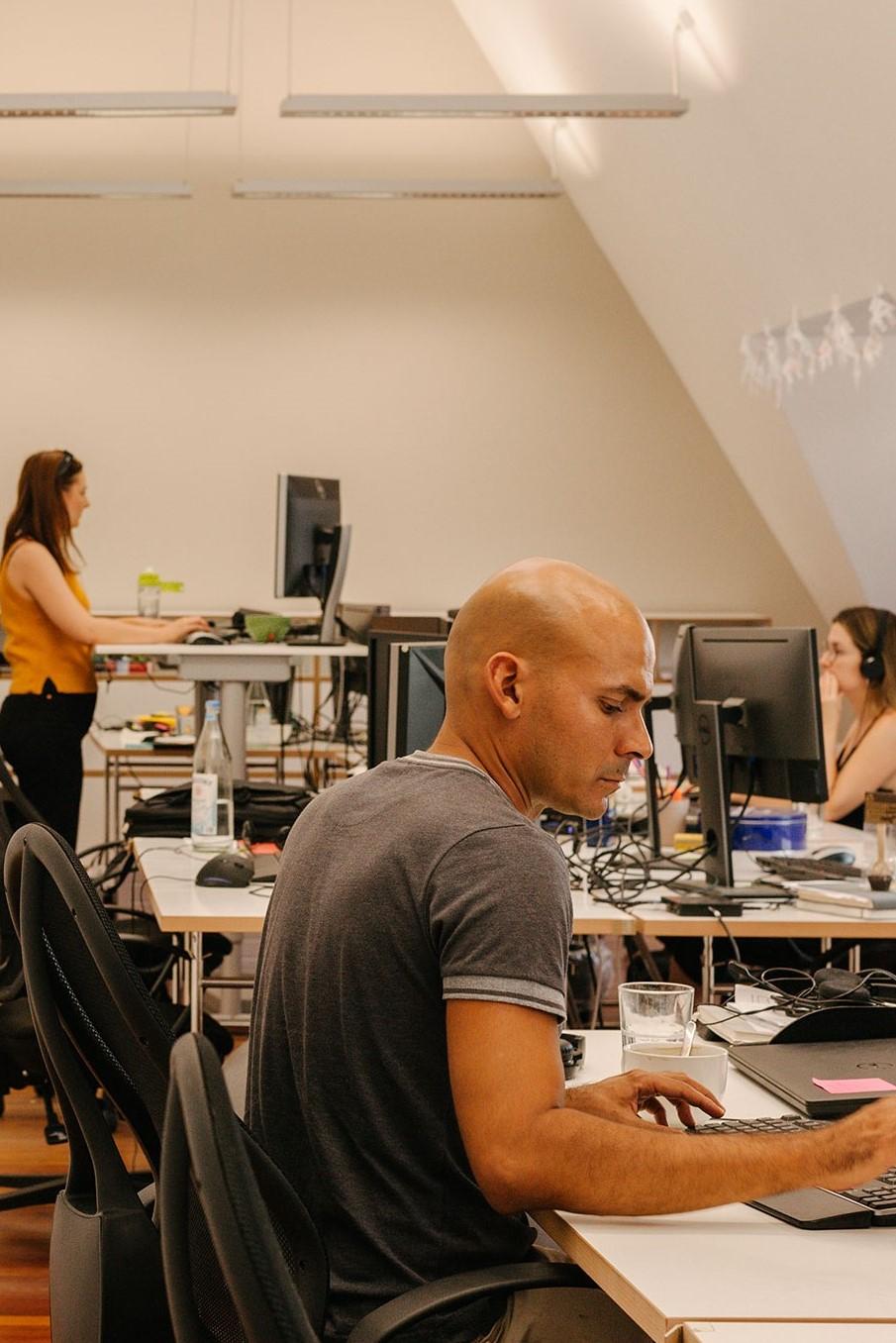ctrl-qs-employees-working-at-their-desks
